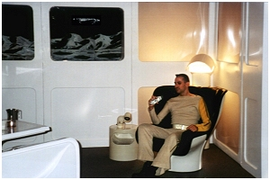 "David sits in the ""Commanders chair"" in the completed Alpha Room exhibit"